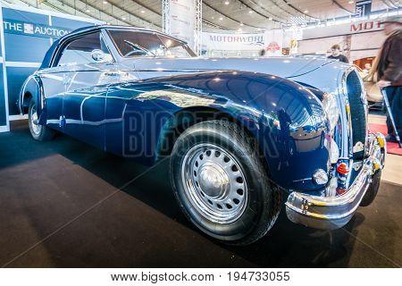 STUTTGART GERMANY - MARCH 17 2016: Luxury car Hotchkiss Anjou 2050 Cabriolet by Worblaufen 1950. HDRi. Europe's greatest classic car exhibition