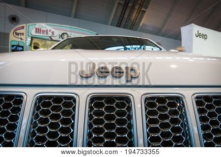 STUTTGART GERMANY - MARCH 17 2016: Detail of mid-size luxury crossover SUV Jeep Grand Cherokee 2015. Europe's greatest classic car exhibition