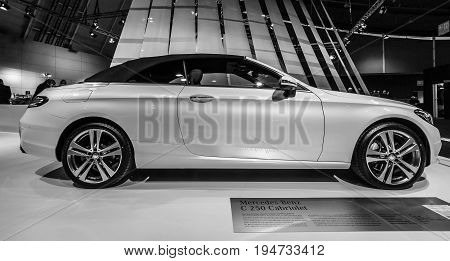 STUTTGART GERMANY - MARCH 17 2016: Compact executive car Mercedes-Benz C250 Cabriolet (W205) 2016. Black and white. Europe's greatest classic car exhibition