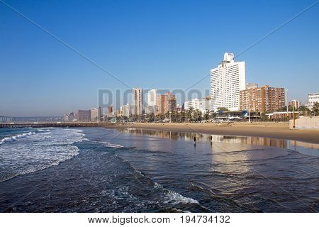 Early morning view from pier of city coastal skyline against blue sky in Durban South Africa