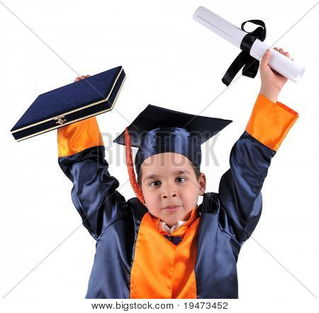 Elementary boy proudly wearing his graduation cap and gown