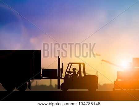 Silhouette driver of the truck was put in the car to transport cargo to customers accurately and securely over blurred pastel background sunset shipping. Heavy industry and Transportation concept.