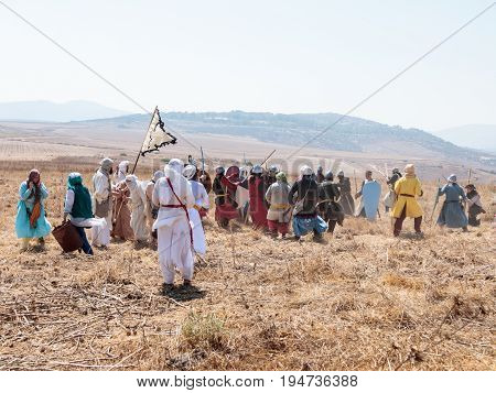Tiberias Israel July 01 2017 : Participants in the reconstruction of Horns of Hattin battle in 1187 participate in the battle on foot on the battlefield near Tiberias Israel