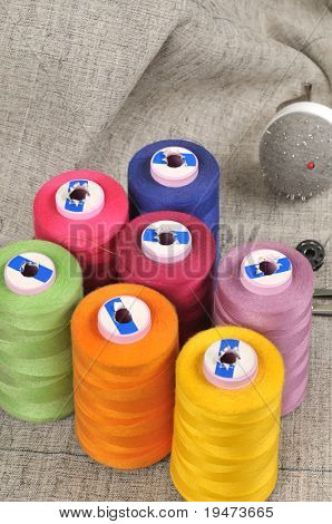 Thread spools and pinhole close up - a series of TAILOR related images.