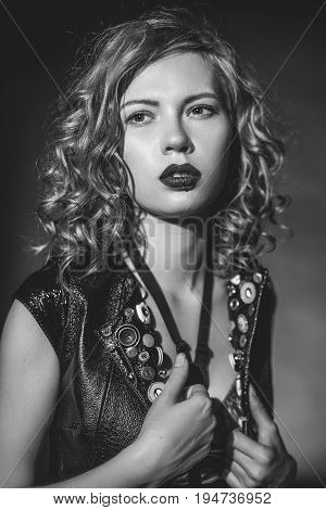 Beautiful girl with wavy hair in the style of rock