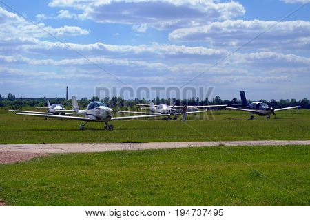 Ultralight Airplanes On The Airfield.