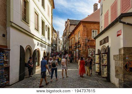 Cesky Krumlov - June 9, 2017: Crowds of tourists on a pedestrian street in the Czech Krumlov, Czech Republic