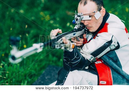 Male Training Sport Shooting With Free Rifle, Toned Image