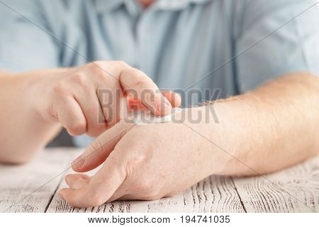 Man Applying Moisturizer Cream On Hands, Dry Skin. Dermatology, Cold Weather Skin Care Concept