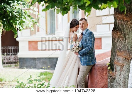 Flawless Wedding Young Couple Walking On City Streets On A Sunny Day.