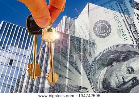 Keys against the facade of the office building and money . The concept of mortgage lending .