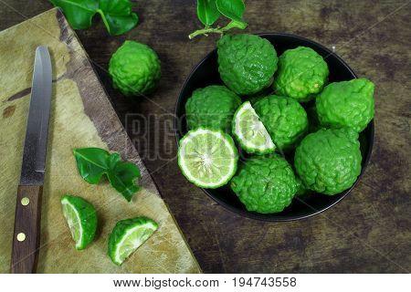 Kaffir lime and kaffir lime leaf on white background