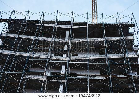 Building Construction Site , with Temporary Scaffolding