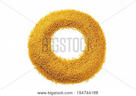 A photo of a circle made of couscous, shot from above on a white background