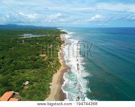 Pacific ocean shoreline aerial drone view. Travel destination in central america