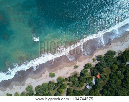 Blue sea water in coastline aerial view. Wild beach at ocean