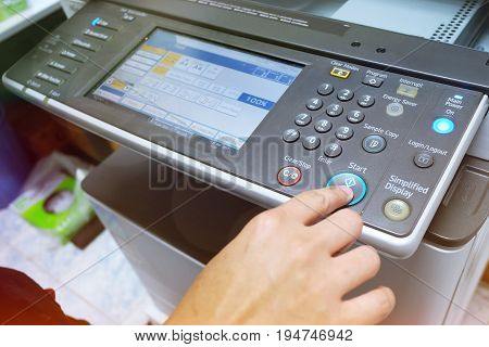 Hand Putting A Sheet Of Paper Into A Copying Device