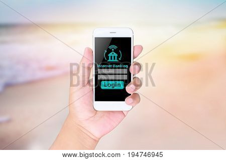 Man Hand Using Internet Banking On A Smart Phone, Blurred Abstract Background