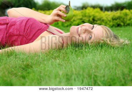 Young Woman Lying On A Lawn