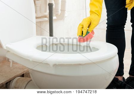 Female Or Housemaid Wiping The Toilet