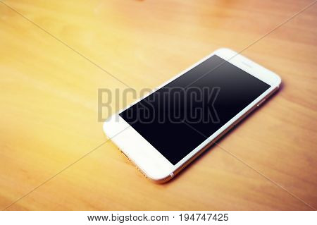 White Smartphone, Isolated On A Wood Background