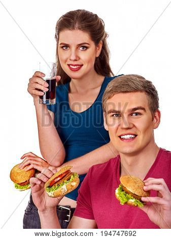 Couple eating fast food. Man and woman treat big hamburger with ham. Friends give burder junk on white background isolated. Food semi-finished products. How to cook quickly and tasty idea.