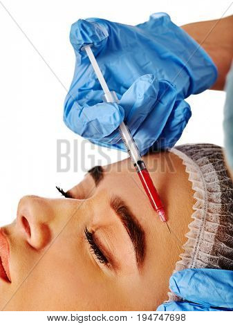 Filler injection for female forehead face. Plastic aesthetic facial surgery by doctor in beauty clinic. Beauty woman giving njections. Expensive procedure wrinkle removal.