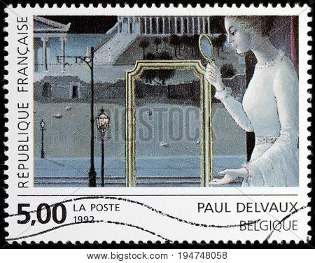 LUGA RUSSIA - APRIL 26 2017: A stamp printed by FRANCE shows painting The appointment of Ephesus by famous Belgian surrealist painter Paul Delvaux circa 1992