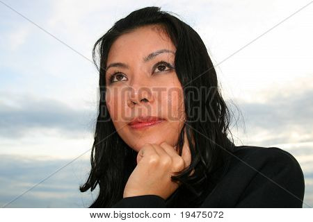 Asian business woman thinking.