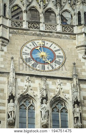 MUNICH GERMANY - MAY 9 2017 : The clock tower of the New Town Hall at Marienplatz in Munich Germany.