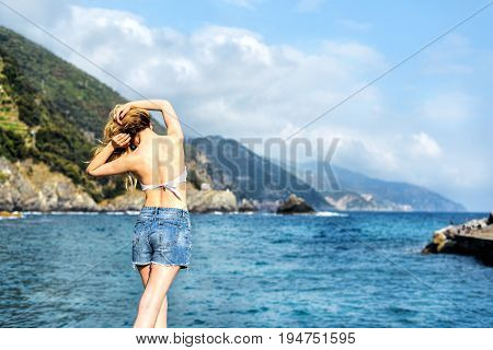 Tourist Girl in Monterosso al Mare Italian riviera. Sea and mountain view. Cinqueterre Liguria beauty