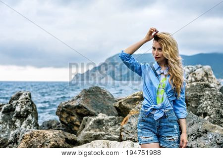 Tourist Girl in Vernazza Cinque terre Italian riviera. Sea and mountain view. Cinqueterre Liguria beauty
