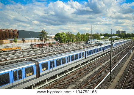 MUNCHEN GERMANY - MAY 9 2017 : A view of the railway with trains on the Frottmaning train station on the U6 subway line in Munich Germany About 350 million passengers ride the U-Bahn every year.
