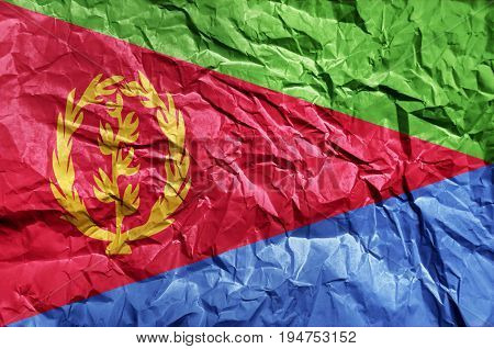 Eritrea flag painted on crumpled paper background