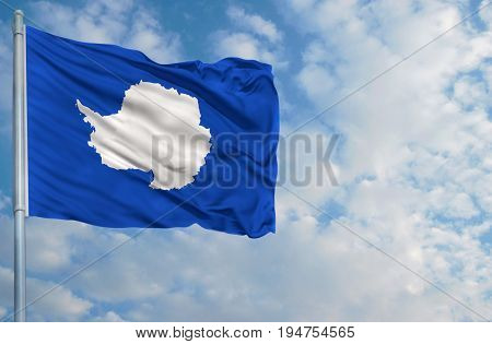 flag of Antarctic on a flagpole in front of blue sky.