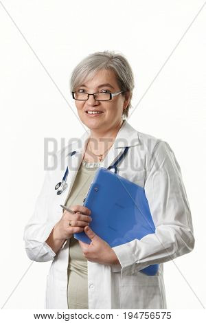 Mature female doctor looking at camera, smiling, isolated on white background.