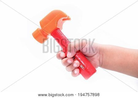 Little Hand Holding A Toy Hammer, Isolated On A White Background