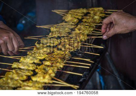 Pork Satay With Peanut Sauce At Street Food Market