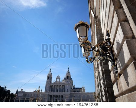 Lighting equipment in area of Palacio Real de Madrid with background of Cathedral de la Almudena