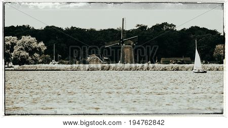 Old Fashioned Black And White Photo Of Sailboat With Family In Summer. The Joppe Lake. Warmond. Zuid