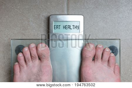 Man's Feet On Weight Scale - Eat Healthy