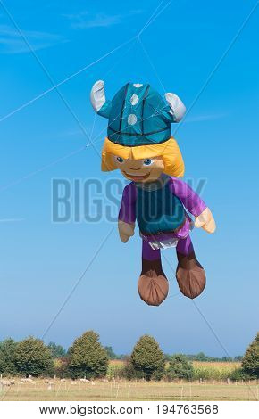 DENEKAMP NETHERLANDS - SEPTEMBER 25 2016: Vicke viking kite against a blue sky during a kite festival