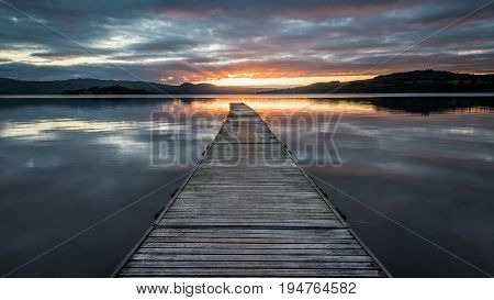 Summer sunrise at a Jetty on Loch Lomond, Scotland