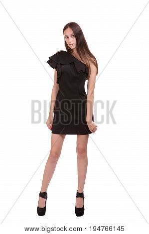 young woman in tight black dress staying on white background