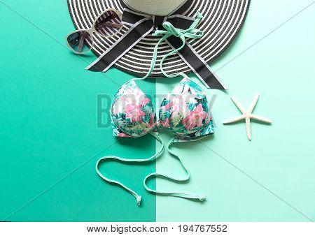 Summer Fashion woman swimsuit Bikini. Tropical sea.Unusual top view colorfull background. Summer Concept.