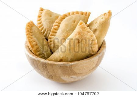 Typical Spanish empanadas in bowl isolated on white background