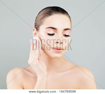 Healthy Woman Spa Model with White Cotton Pads. Hygienic Cleansing and Facial Treatment Concept