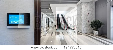 smart screen with spacious center with escalator in modern office building