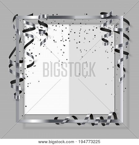 Silver frame with silver and black ribbon serpentine dust and white paper