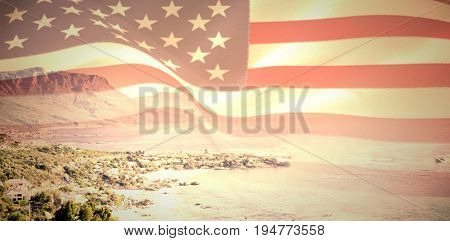 Digitally generated united states national flag against view of beautiful coastline